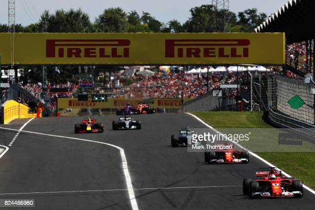 Sebastian Vettel of Germany driving the Scuderia Ferrari SF70H leads the field during the Formula One Grand Prix of Hungary at Hungaroring on July 30...