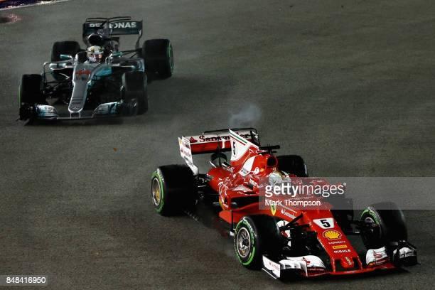 Sebastian Vettel of Germany driving the Scuderia Ferrari SF70H leads Lewis Hamilton of Great Britain driving the Mercedes AMG Petronas F1 Team...