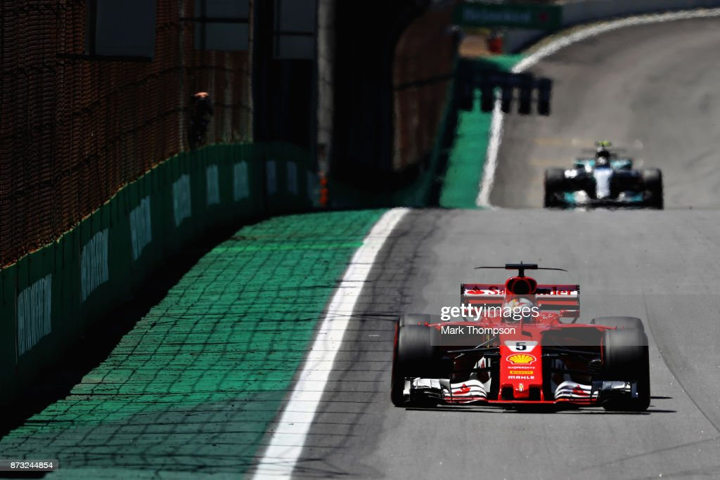Sebastian Vettel of Germany driving the (5) Scuderia Ferrari SF70H leads Valtteri Bottas driving the (77) Mercedes AMG Petronas F1 Team Mercedes F1 WO8 on track during the Formula One Grand Prix of Brazil at Autodromo Jose Carlos Pace on November 12, 2017 in Sao Paulo, Brazil.