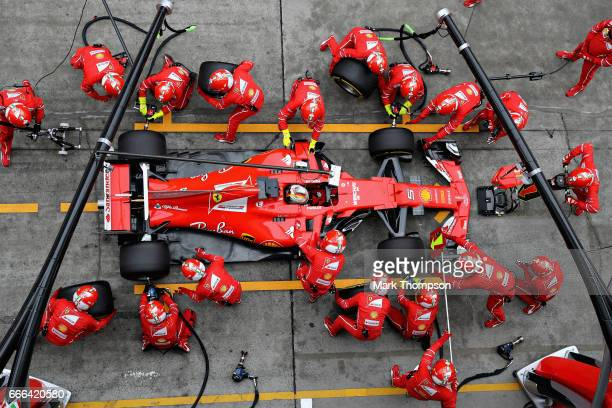 Sebastian Vettel of Germany driving the Scuderia Ferrari SF70H makes a pit stop for new tyres during the Formula One Grand Prix of China at Shanghai...