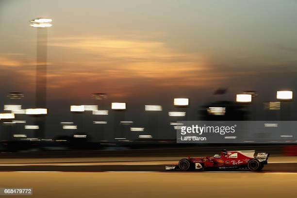 Sebastian Vettel of Germany driving the Scuderia Ferrari SF70H on track during practice for the Bahrain Formula One Grand Prix at Bahrain...
