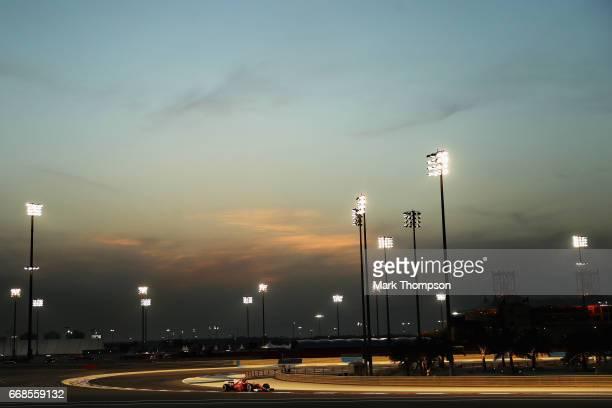 Sebastian Vettel of Germany driving the Scuderia Ferrari SF70H on track during practice for the Bahrain Formula One Grand Prix at Bahrain...