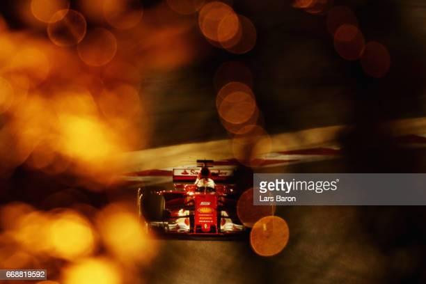 Sebastian Vettel of Germany driving the Scuderia Ferrari SF70H on track during qualifying for the Bahrain Formula One Grand Prix at Bahrain...