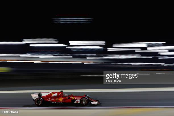 Sebastian Vettel of Germany driving the Scuderia Ferrari SF70H on track during qualifying for the Bahrain Formula One Grand Prix at Bahrain...