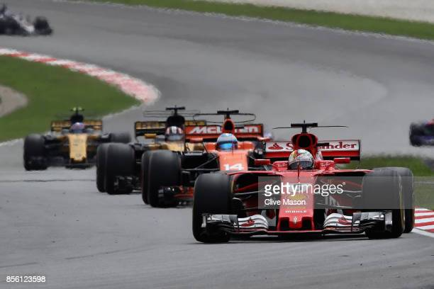 Sebastian Vettel of Germany driving the Scuderia Ferrari SF70H on track during the Malaysia Formula One Grand Prix at Sepang Circuit on October 1,...
