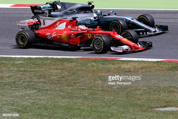 Sebastian Vettel of Germany driving the Scuderia Ferrari SF70H overtakes Valtteri Bottas driving the Mercedes AMG Petronas F1 Team Mercedes F1 WO8 on...