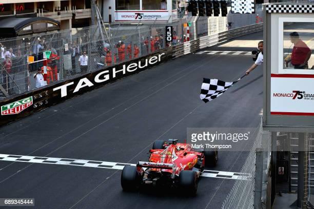 Sebastian Vettel of Germany driving the Scuderia Ferrari SF70H crosses the line to take the win during the Monaco Formula One Grand Prix at Circuit...