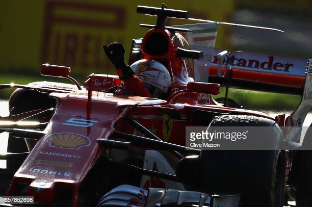 Sebastian Vettel of Germany driving the Scuderia Ferrari SF70H waves to the crowd after winning the Australian Formula One Grand Prix at Albert Park...
