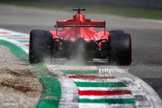 Sebastian Vettel of Germany driving the Scuderia Ferrari SF71H kicks up gravel after running wide during qualifying for the Formula One Grand Prix of...