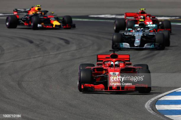 Mercedes' British driver Lewis Hamilton drives ahead of Mercedes' Finnish driver Valtteri Bottas a during the German Formula One Grand Prix at the...