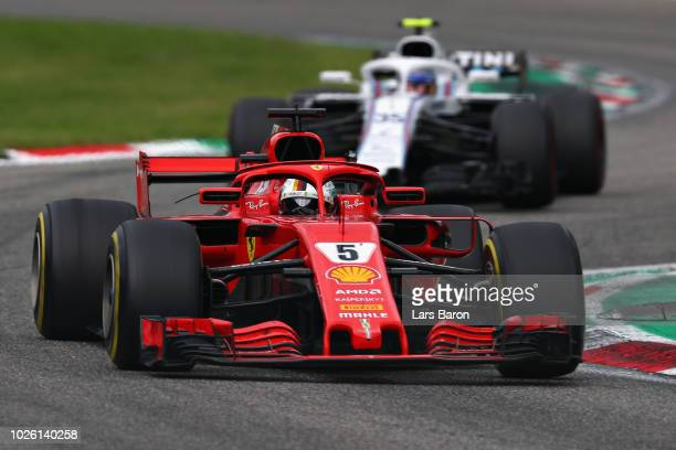 Sebastian Vettel of Germany driving the Scuderia Ferrari SF71H leads Sergey Sirotkin of Russia driving the Williams Martini Racing FW41 Mercedes on...