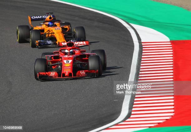 Sebastian Vettel of Germany driving the Scuderia Ferrari SF71H leads Fernando Alonso of Spain driving the McLaren F1 Team MCL33 Renault on track...