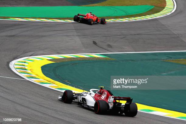 Sebastian Vettel of Germany driving the Scuderia Ferrari SF71H leads Charles Leclerc of Monaco driving the Alfa Romeo Sauber F1 Team C37 Ferrari on...