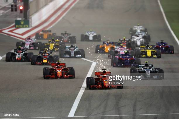 Sebastian Vettel of Germany driving the Scuderia Ferrari SF71H leads Kimi Raikkonen of Finland driving the Scuderia Ferrari SF71H Valtteri Bottas...