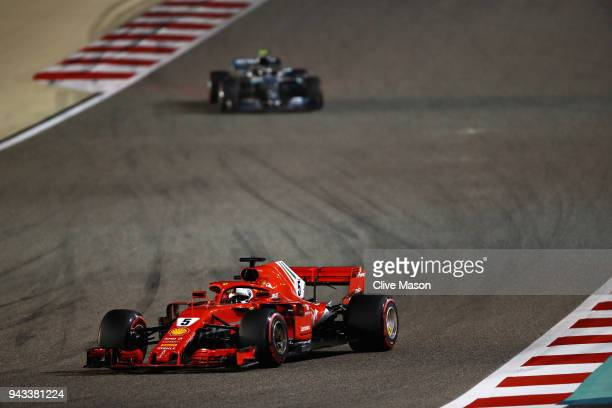Sebastian Vettel of Germany driving the Scuderia Ferrari SF71H leads Valtteri Bottas driving the Mercedes AMG Petronas F1 Team Mercedes WO9 on track...