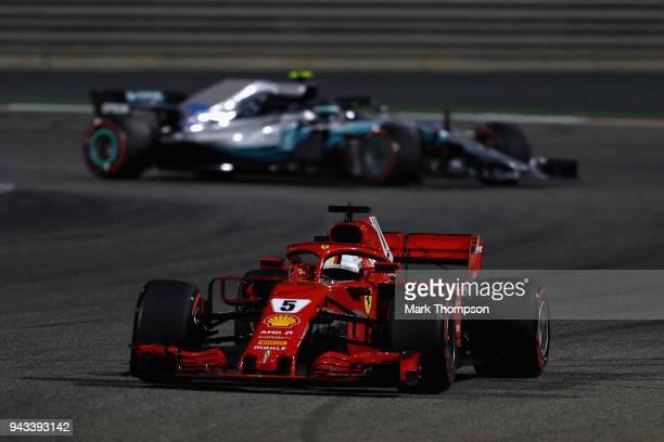 Sebastian Vettel of Germany driving the Scuderia Ferrari SF71H leads Valtteri Bottas driving the Mercedes AMG Petronas F1 Team Mercedes WO9 on track...
