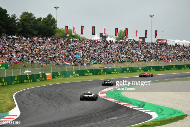 Sebastian Vettel of Germany driving the Scuderia Ferrari SF71H leads Lewis Hamilton of Great Britain driving the Mercedes AMG Petronas F1 Team...