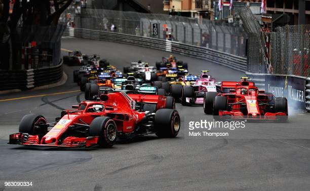 Sebastian Vettel of Germany driving the Scuderia Ferrari SF71H leads Kimi Raikkonen of Finland driving the Scuderia Ferrari SF71H on track during the...