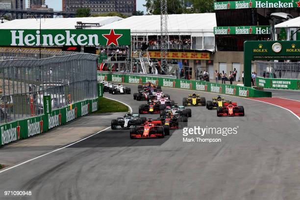 Sebastian Vettel of Germany driving the Scuderia Ferrari SF71H leads the field at the start during the Canadian Formula One Grand Prix at Circuit...