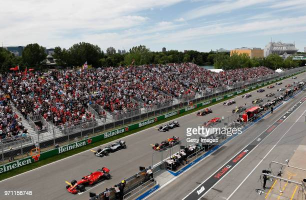 Sebastian Vettel of Germany driving the Scuderia Ferrari SF71H leads the field off the start line during the Canadian Formula One Grand Prix at...