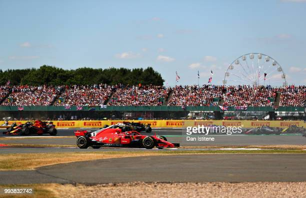 Sebastian Vettel of Germany driving the Scuderia Ferrari SF71H leads the field during the Formula One Grand Prix of Great Britain at Silverstone on...