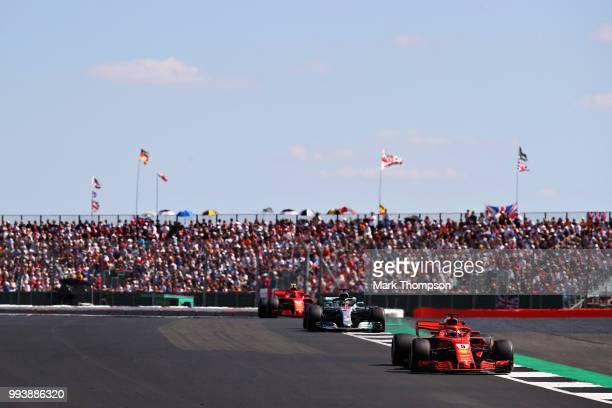 Sebastian Vettel of Germany driving the Scuderia Ferrari SF71H leads Lewis Hamilton of Great Britain driving the Mercedes AMG Petronas F1 Team...