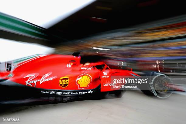 Sebastian Vettel of Germany driving the Scuderia Ferrari SF71H leaves the garage during practice for the Formula One Grand Prix of China at Shanghai...