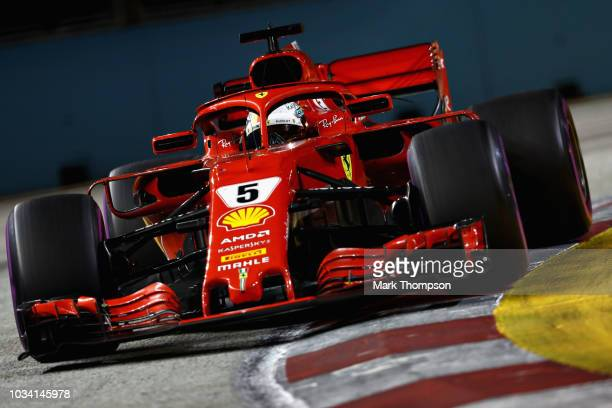 Sebastian Vettel of Germany driving the Scuderia Ferrari SF71H on track during the Formula One Grand Prix of Singapore at Marina Bay Street Circuit...