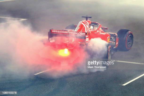 Sebastian Vettel of Germany driving the Scuderia Ferrari SF71H performs donuts on the pit straight during the Abu Dhabi Formula One Grand Prix at Yas...