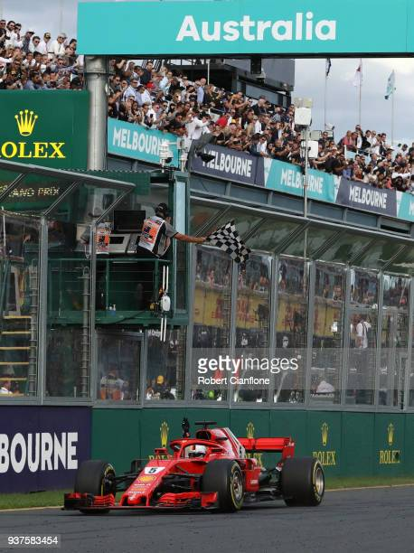 Sebastian Vettel of Germany driving the Scuderia Ferrari SF71H takes the chequered flag and the win during the Australian Formula One Grand Prix at...