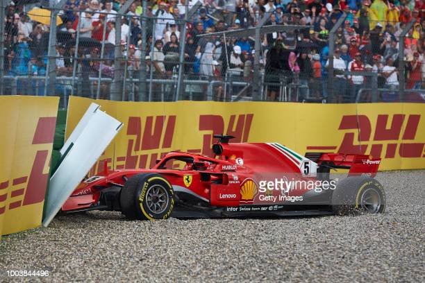 Sebastian Vettel of Germany driving the Scuderia Ferrari SF71H crashes during the Formula One Grand Prix of Germany at Hockenheimring on July 22 2018...