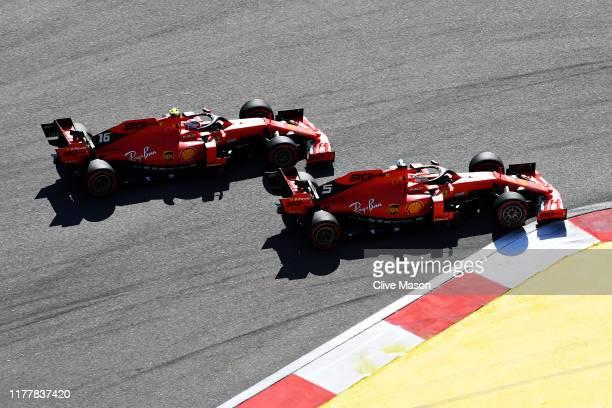 Sebastian Vettel of Germany driving the Scuderia Ferrari SF90 and Charles Leclerc of Monaco driving the Scuderia Ferrari SF90 battle for position at...