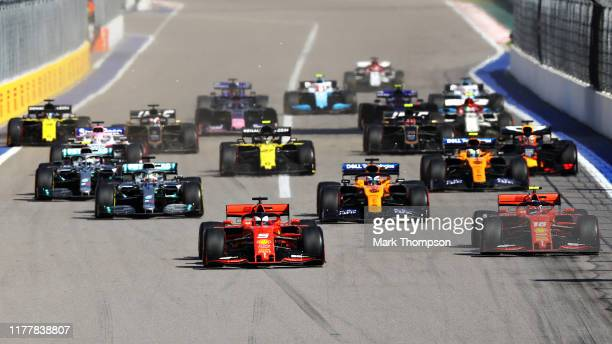 Sebastian Vettel of Germany driving the Scuderia Ferrari SF90 and Charles Leclerc of Monaco driving the Scuderia Ferrari SF90 battle for position at...
