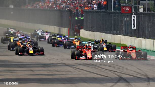 Sebastian Vettel of Germany driving the Scuderia Ferrari SF90 and Charles Leclerc of Monaco driving the Scuderia Ferrari SF90 lead Max Verstappen of...