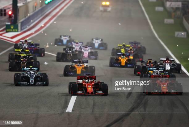 Sebastian Vettel of Germany driving the Scuderia Ferrari SF90 battles for position with Charles Leclerc of Monaco driving the Scuderia Ferrari SF90...