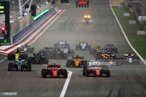 Sebastian Vettel of Germany driving the Scuderia Ferrari SF90 leads the field at the start during the F1 Grand Prix of Bahrain at Bahrain...