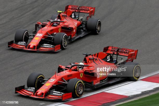 Sebastian Vettel of Germany driving the Scuderia Ferrari SF90 leads Charles Leclerc of Monaco driving the Scuderia Ferrari SF90 on track during the...