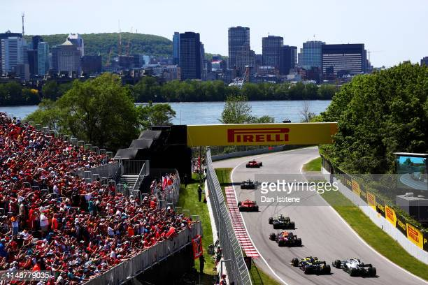 Sebastian Vettel of Germany driving the Scuderia Ferrari SF90 leads the field including Pierre Gasly of France and Red Bull Racing during the F1...