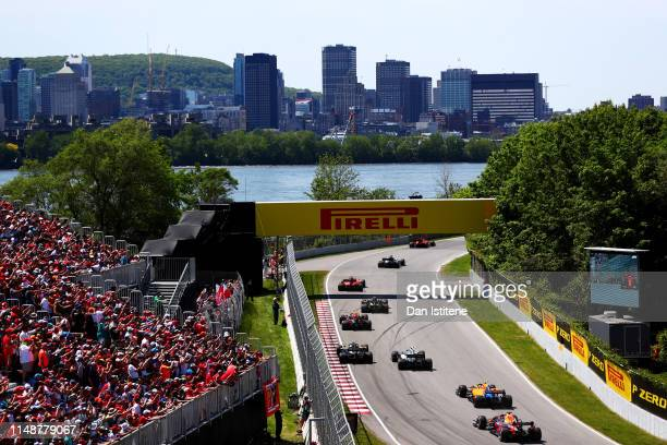 Sebastian Vettel of Germany driving the Scuderia Ferrari SF90 leads the field including Pierre Gasly of France and Red Bull Racing and Max Verstappen...