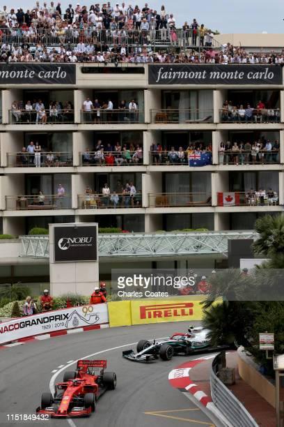 Sebastian Vettel of Germany driving the Scuderia Ferrari SF90 leads Valtteri Bottas driving the Mercedes AMG Petronas F1 Team Mercedes W10 on track...