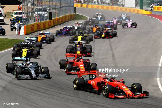 Sebastian Vettel of Germany driving the Scuderia Ferrari SF90 leads Lewis Hamilton of Great Britain driving the Mercedes AMG Petronas F1 Team...