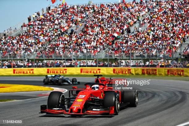 Sebastian Vettel of Germany driving the Scuderia Ferrari SF90 leads Lewis Hamilton of Great Britain driving the Mercedes AMG Petronas F1 Team...