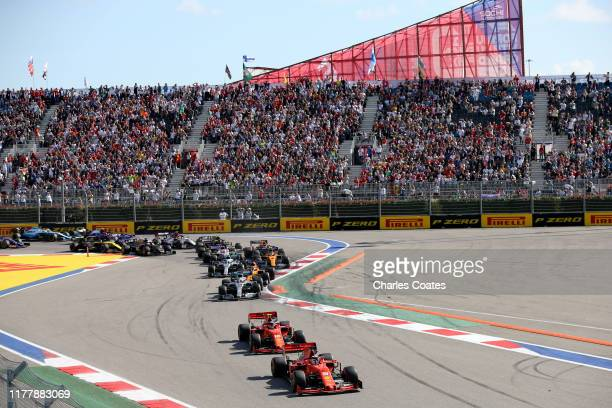 Sebastian Vettel of Germany driving the Scuderia Ferrari SF90 leads Charles Leclerc of Monaco driving the Scuderia Ferrari SF90 and the rest of the...