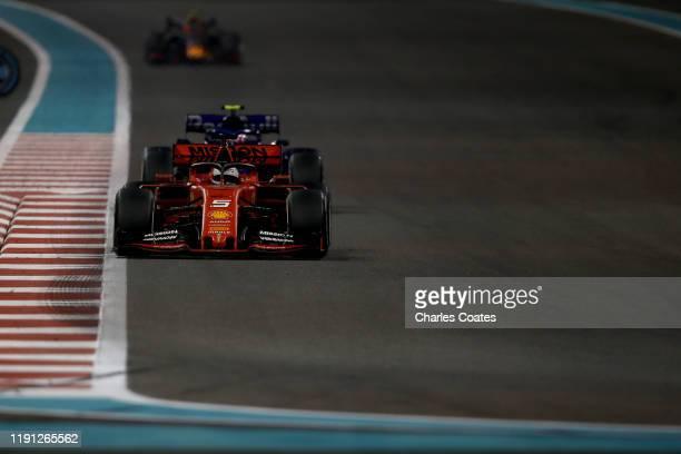 Sebastian Vettel of Germany driving the Scuderia Ferrari SF90 leads Pierre Gasly of France driving the Scuderia Toro Rosso STR14 Honda on track...