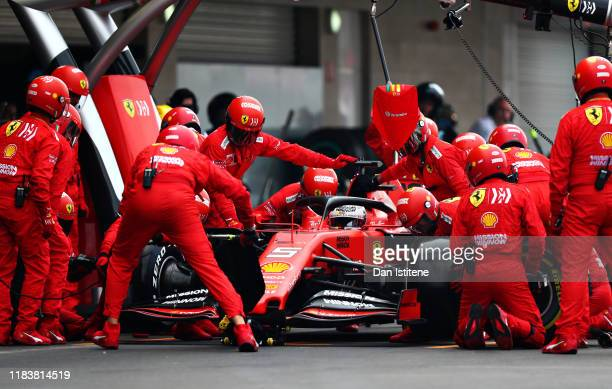 Sebastian Vettel of Germany driving the Scuderia Ferrari SF90 makes a pit stop for new tyres during the F1 Grand Prix of Mexico at Autodromo Hermanos...