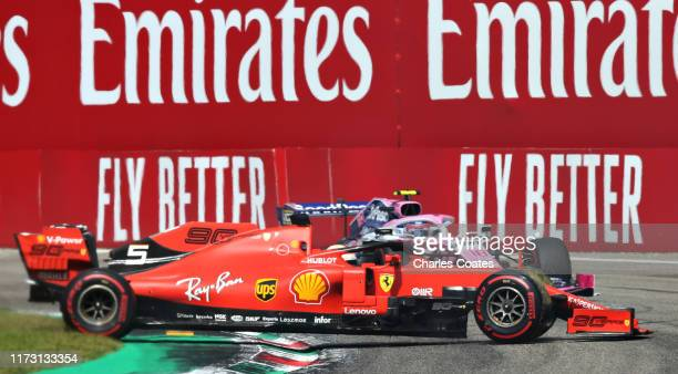 Sebastian Vettel of Germany driving the Scuderia Ferrari SF90 spins with Lance Stroll of Canada driving the Racing Point RP19 Mercedes behind during...