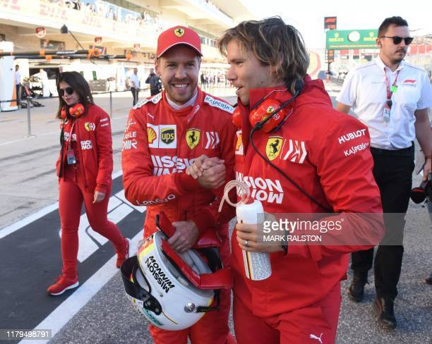 Sebastian Vettel of Germany from the Scuderia Ferrari team smiles after taking second place on the grid in the quallifying session of the F1 Grand...