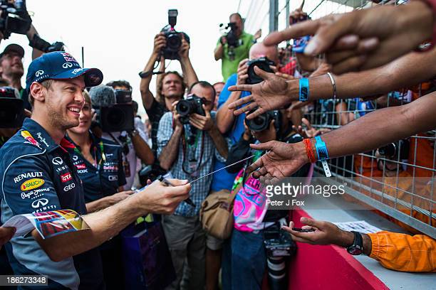 Sebastian Vettel of Red Bull and Germany greets fans during the Indian Formula One Grand Prix at Buddh International Circuit on October 27 2013 in...
