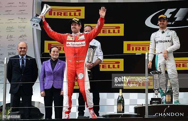 Sebastian Vettel of Scuderia Ferrari celebrates his win in parc ferme during the Formula One Grand Prix of China at Shanghai International Circuit on...