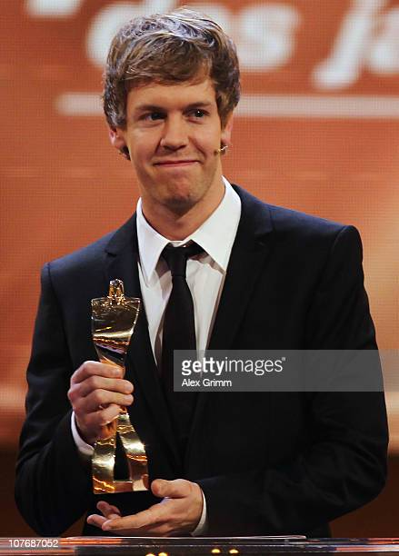 Sebastian Vettel reacts after being awarded 'Athlete of the year 2010' during a gala at the Kurhaus Baden-Baden on December 19, 2010 in Baden Baden,...